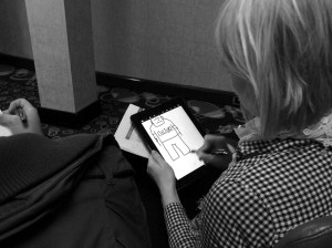 Virpi Oinonen drawing on an ipad at spsuk event